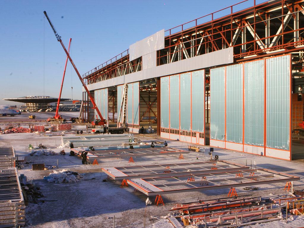 Подготовка-строительного-объекта-Ангарные-ворота-и-нестандартные-конструкции-по-индивидуальным-проектам ДорХан